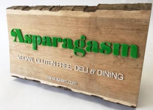 Oak and laser cut acrylic bespoke sign for Asaparagasm.