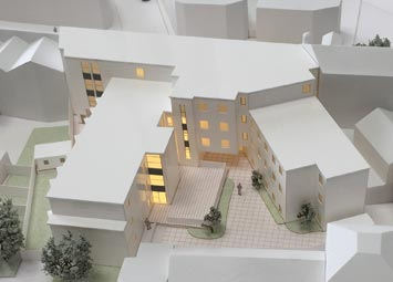 White architectural model main site building with integrated lighting.