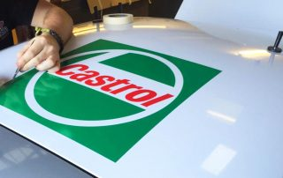 Apllying Castrol vinyl graphics sega rally car