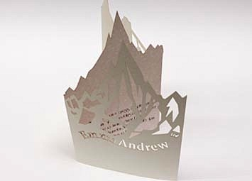 Laser cut card wedding invites.