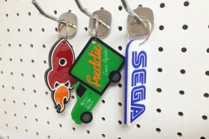 Three laser cut keyrings make from laser cut and engraved acrylic.