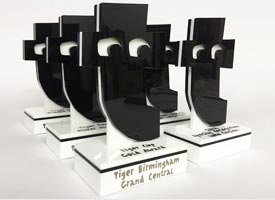Employee awards for Tiger made from white and black laser cut acrylic.