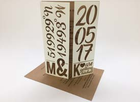 Card laser cut wedding invitaion with printed insert.