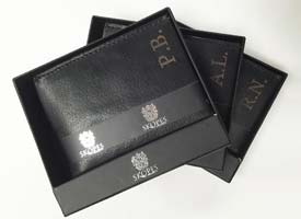 Leather engraving on wallets with buiness logo.