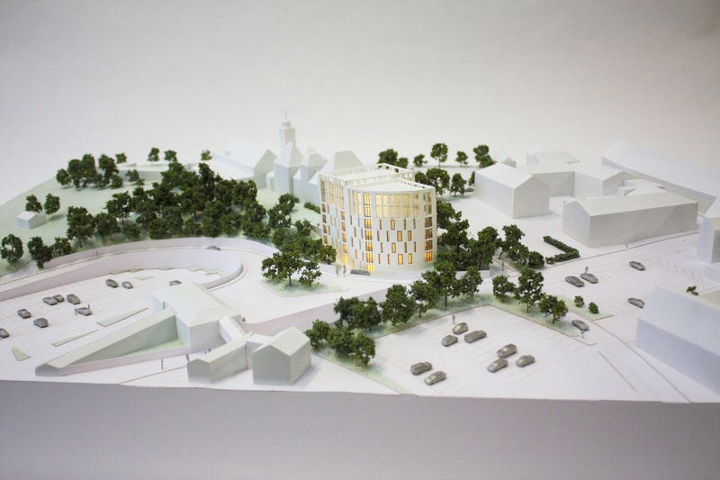 We are an architectual model maker, this is a 1:200 white architectural model of a flat development from laser cut acrylic.