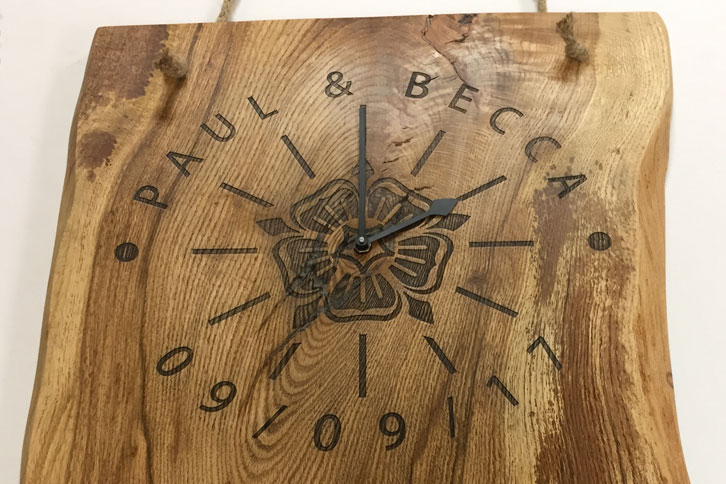 Solid oak, engraved wood clock.