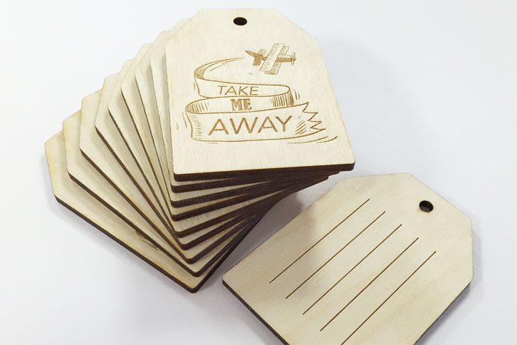 Laser engraved plywood luggage tags