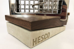 Close up of concrete and walnut trophy bases for Hesco