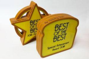 Personalised bespoke trophies for Allied Bakery, made using CNC milling.