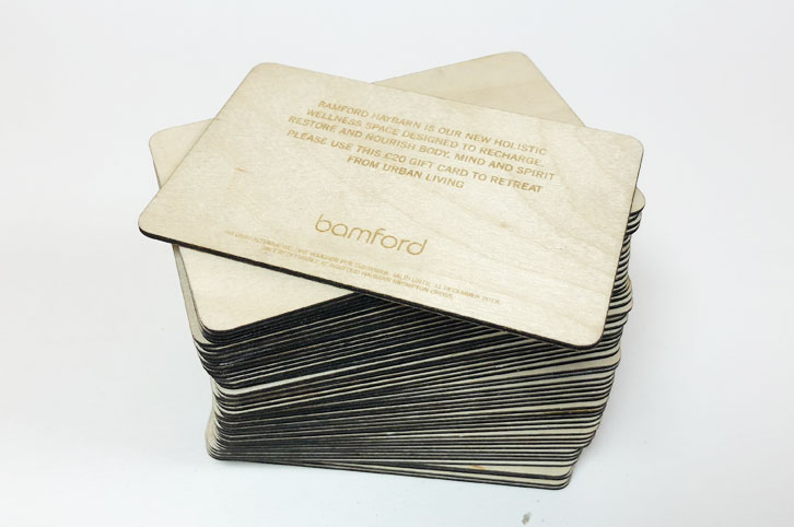 Laser engraved plywood vouchers for Bamford marketting..