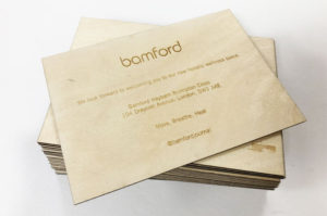 Laser engraved 1.5mm plywood inviations for Bamford marketting..