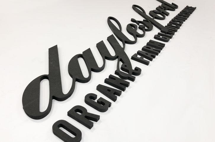 Large letters, CNC cut MDF signage.
