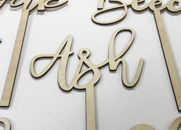 Laser cut plywood table names for wedding tables.