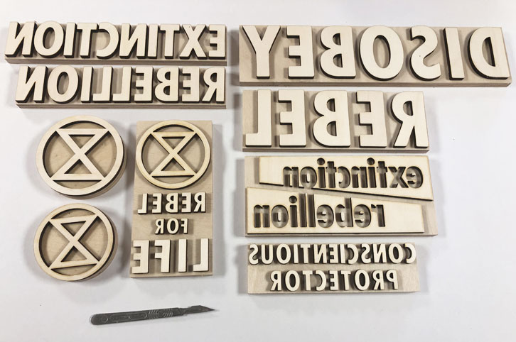 Wood print blocks laser cut for Extinction Rebellion