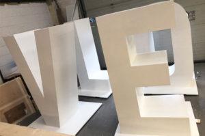 Large 3d cnc cut letters, painted white.