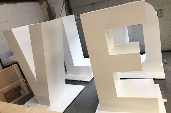 Large 3d cnc cut letters, painted white.