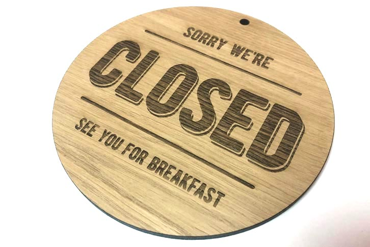 Laser etched wood shop sign