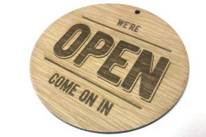 Laser etched wood shop sign