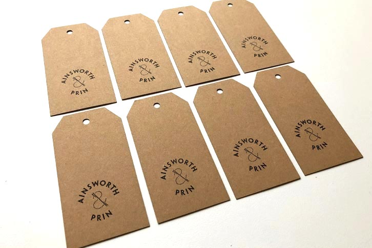 Laser cut hand stamped tags on recycled card