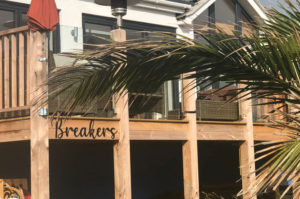 CNC machined acrylic lettering for beach house signage