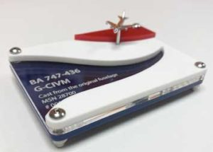 Laser cut acrylic display stand for a model BA airplane. Laser cut from blue, clear, white and red acrylic with model details engraved on the clear acrylic.