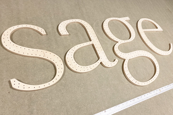CNC cut large letters cut from 9mm birch plywood.