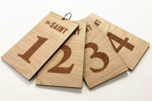 Laser cut and engraved cherry wood keyring fobs for hotel keys. Laser etched with room numbers and hotel logo..