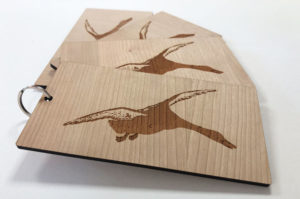 Laser cut and engraved cherry wood keyring fobs for hotel keys. Laser etched with duck logo.